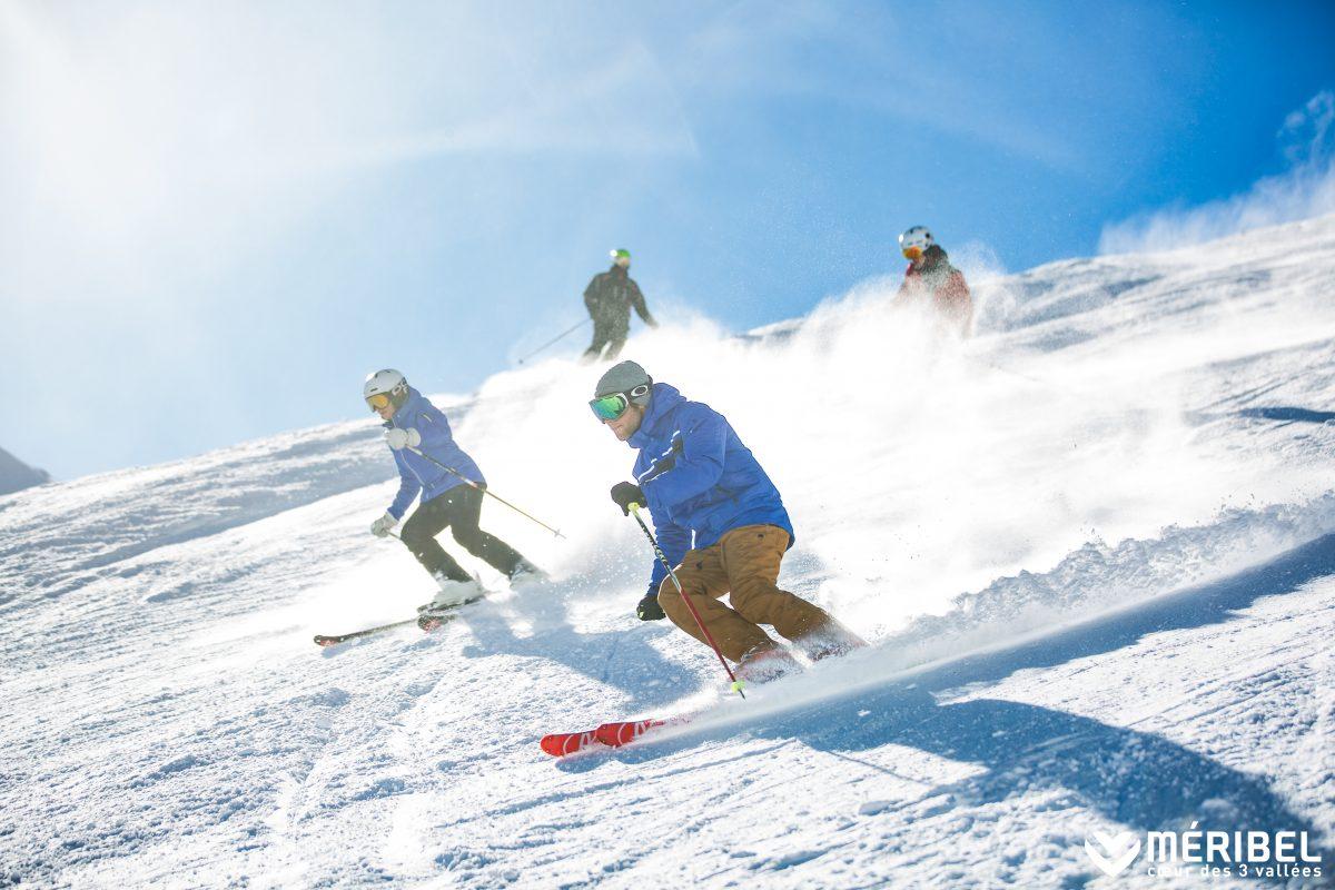 Group of people skiing in Meribel