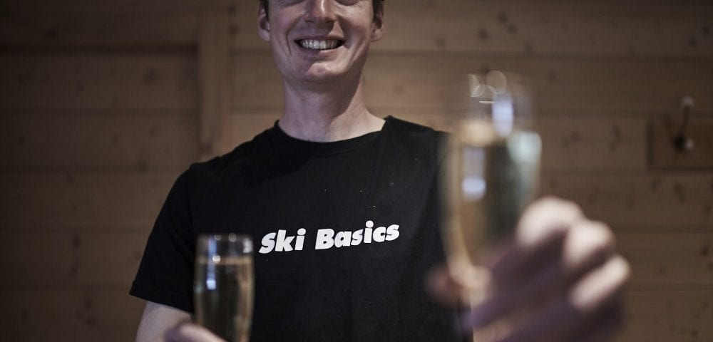Ski Basics staff handing champagne flute to the camera