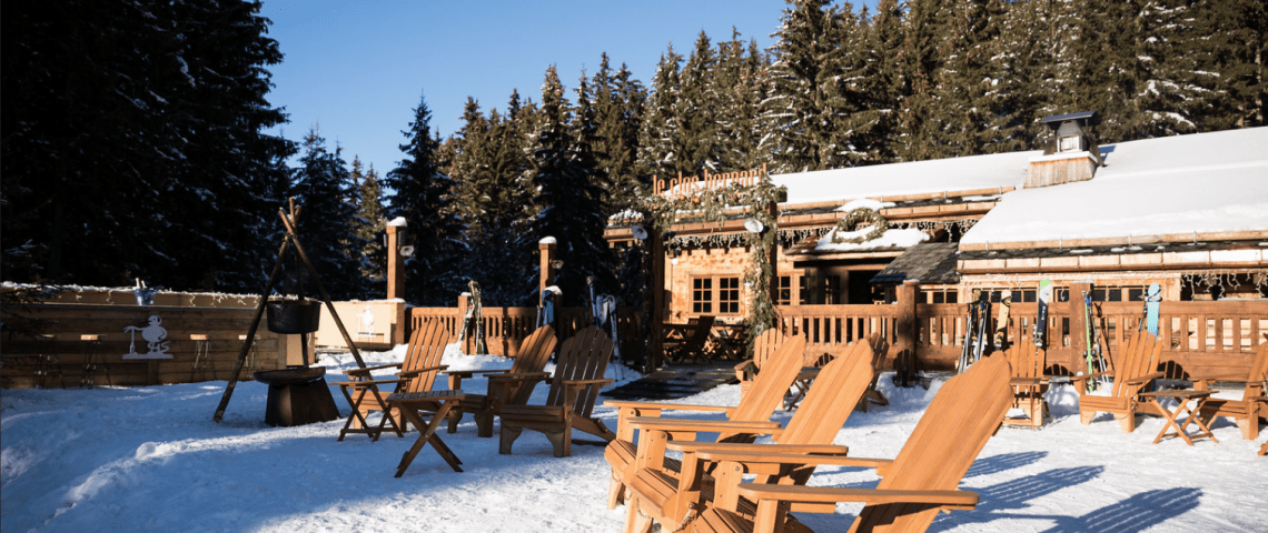 Wooden chairs in the sun on the snow